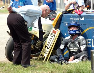 Always first on the scene! In 2007 Sunday Life reporter Jimmy Walker is the first man to interview an exhausted Darren Burns after Burns pushed his bike across the line in the 250cc race at the Tandragee 100 when his chain broke with just a few metres to go.