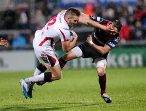 Ulster's Stuart McCloskey is tackled by the Dragons Jason Tovey. Darren Kidd / Press Eye.