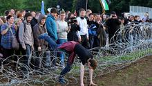 G8 Protesters break through an outer fence during a protest near the G8  summit in Loch Erne, Enniskillen. PRESS ASSOCIATION Photo. Picture date: Monday June 17, 2013. Photo credit should read: Paul Faith/PA Wire