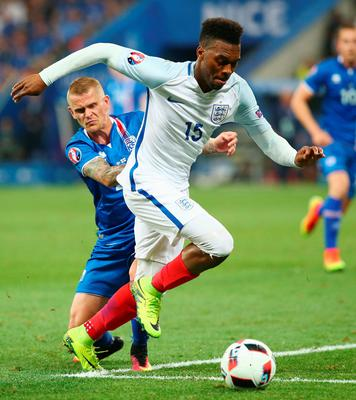 NICE, FRANCE - JUNE 27:  Daniel Sturridge of England and Ari Skulason of Iceland compete for the ball during the UEFA EURO 2016 round of 16 match between England and Iceland at Allianz Riviera Stadium on June 27, 2016 in Nice, France.  (Photo by Alex Livesey/Getty Images)