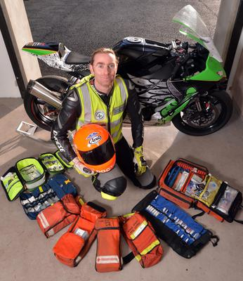 Dr John Hinds with the ZX10 Kawasaki he uses as a travelling race doctor and the medical kit that he carries. Pic Stephen Davison