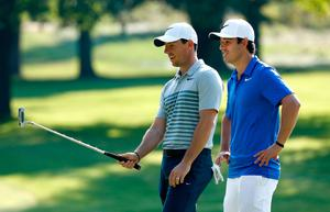 AKRON, OH - AUGUST 02:  Rory McIlroy of Northern Ireland speaks to his new caddie Harry Diamond during a preview day of the World Golf Championships - Bridgestone Invitational at Firestone Country Club South Course on August 2, 2017 in Akron, Ohio.  (Photo by Sam Greenwood/Getty Images)