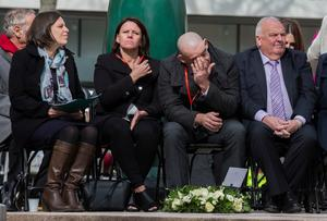 Paul Comerford (second right) the brother of Johnathan Ball, three, who along with Tim Parry, 12, was killed after the IRA detonated two bombs on Bridge Street, in Warrington, wipes his eyes during the 25th anniversary service in Warrington of the bombing attack. PRESS ASSOCIATION Photo. Picture date: Tuesday March 20, 2018. See PA story MEMORIAL Warrington. Photo credit should read: Peter Byrne/PA Wire