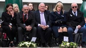 Wendy and Colin Parry (both right), the parents of Tim Parry, 12, and Paul Comerford (second left) the brother of Johnathan Ball, three, who were both killed in the IRA Warrington bombing attack, sit during the 25th anniversary service of the Warrington bombing, on Bridge Street, attended by the families of victims of the attack, faith leaders and representatives of the British and Irish governments. PRESS ASSOCIATION Photo. Picture date: Tuesday March 20, 2018. See PA story MEMORIAL Warrington. Photo credit should read: Peter Byrne/PA Wire