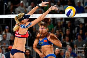 USA's Kerri Walsh Jennings (L) tries to block the ball during the women's beach volleyball qualifying match between the USA and China at the Beach Volley Arena in Rio de Janeiro late on August 8, 2016, for the Rio 2016 Olympic Games. / AFP PHOTO / Leon NEALLEON NEAL/AFP/Getty Images