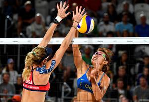China's Yue Yuan spikes the ball during the women's beach volleyball qualifying match between the USA and China at the Beach Volley Arena in Rio de Janeiro late on August 8, 2016, for the Rio 2016 Olympic Games. / AFP PHOTO / Leon NEALLEON NEAL/AFP/Getty Images