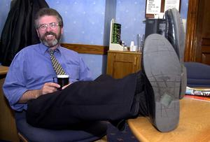 PACEMAKER BFST 11-06-2001:Sinn Fein's Gerry Adams can put his feet up and relax after a gruelling few weeks on the campaign trail after a sucessful Westminster Election and local  council election. He is pictured at the local election count at Belfast City Hall.