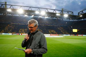 Dortmund's Norbert Dickel announces the postponementof the match after the team bus of Borussia Dortmund had some windows broken by an explosion some 10km away from the stadium prior to the UEFA Champions League 1st leg quarter-final football match BVB Borussia Dortmund v Monaco in Dortmund, western Germany on April 11, 2017. / AFP PHOTO / Odd ANDERSENODD ANDERSEN/AFP/Getty Images