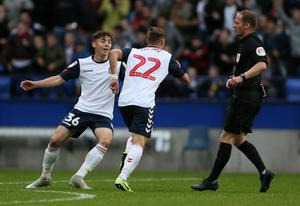 Bolton's Dennis Politic celebrates opening the scoring (Richard Sellers/PA).