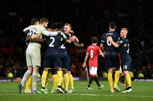 Southampton's players celebrate after the Barclays Premier League match at Old Trafford, Manchester. Martin Rickett/PA Wire.