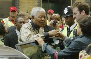 LONDON - JULY 11:  Nelson Mandela visits Saint Michael's Community Space July 11, 2003 in London. Mandela paid a personal tribute to two prominent anti-apartheid activists former home.  (Photo by Gareth Cattermole/Getty Images)