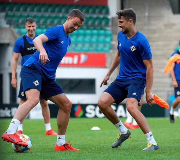 Having a ball: Jonny Evans and Craig Cathcart train at the Le Coq Arena
