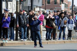 BOSTON, MA - APRIL 15:  People look on after two bombs exploded during the 117th Boston Marathon on April 15, 2013 in Boston, Massachusetts. Two people are confirmed dead and at least 28 injured after at least two explosions went off near the finish line to the marathon.  (Photo by Darren McCollester /Getty Images)