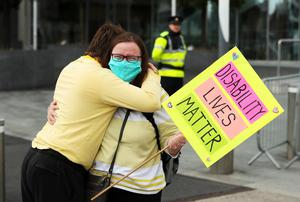 Brid Casey and her son Darragh Burns at the protest outside the Dail (Brian Lawless/PA)