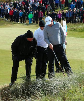 NEWCASTLE, NORTHERN IRELAND - MAY 29:  Padraig Harrington of Ireland gets a ruling on the 18th hole as Sergio Garcia of Spain looks on during the Second Round of the Dubai Duty Free Irish Open Hosted by the Rory Foundation at Royal County Down Golf Club on May 29, 2015 in Newcastle, Northern Ireland.  (Photo by Andrew Redington/Getty Images)