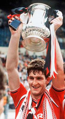 Norman lifts the cup for United