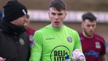 Warrenpoint goalkeeper Mark Byrne was involved in an incident with spectators in injury-time, which saw the fence collapse and fans spill onto the field.