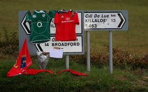 Signs point the way to Killaloe in County Clare where the coffin of Munster Rugby head coach Anthony Foley has been brought to repose in St. Flannan's Church, ahead off his funeral tomorrow. PA