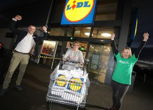 Big help: Fiona McToal, who won the trolley dash with (left) Lidl Northern Ireland's head of sales operations, Gordon Cruikshanks and Joanne McMaster, supporter fundraising manager at NSPCC Northern Ireland