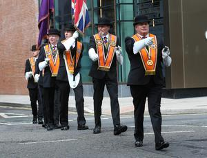 PACEMAKER, BELFAST, 13/7/2020: Members of the Belfast County Colour party in Belfast city centre today where they took part in a memorial service at the City Hall Cenotaph. The Orange Order did not take part in their traditional Twelfth of July processions this year because of the restrictions around Coronavirus although there were band parades around local areas across Northern Ireland. PICTURE BY STEPHEN DAVISON
