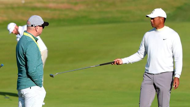 Rickie Fowler (left) and Tiger Woods on the 1st green during preview day two of The Open Championship 2019 at Royal Portrush Golf Club.