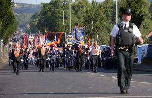 Press Eye - Belfast - Northern Ireland  - 12th July 2017 -   Bandsmen and members of the Orange Order march down the Crumlin Road, past Ardoyne shops, in North Belfast after a deal was struck last year between the Orange Order and the Ardoyne Residents Association.   Orangemen from across Northern Ireland will rake part in the annual commemoration of William of Orange's victory over King James II at the Battle of the Boyne in 1690.  Photo by Kelvin Boyes / Press Eye.