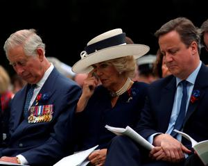 THIEPVAL, FRANCE - JULY 1:  (L-R) Prince Charles, Prince of Wales with Camilla, Duchess of Cornwall and Prime Minister David Cameron during the Commemoration of the Centenary of the Battle of the Somme at the Commonwealth War Graves Commission Thiepval Memorial on July 1, 2016 in Thiepval, France. The event is part of the Commemoration of the Centenary of the Battle of the Somme at the Commonwealth War Graves Commission Thiepval Memorial in Thiepval, France, where 70,000 British and Commonwealth soldiers with no known grave are commemorated. (Photo by Steve Parsons - Pool/Getty Images)