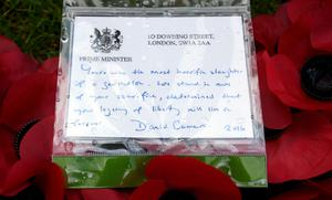 THIEPVAL, FRANCE - JULY 1: Detailed view of the note on the wreath left by Prime Minister David Cameron   at the Cross of Sacrifice after the Commemoration of the Centenary of the Battle of the Somme at the Commonwealth War Graves Commission Thiepval Memorial on July 1, 2016 in Thiepval, France. The event is part of the Commemoration of the Centenary of the Battle of the Somme at the Commonwealth War Graves Commission Thiepval Memorial on July 1, 2016 in Thiepval, France. where 70,000 British and Commonwealth soldiers with no known grave are commemorated. (Photo by Andrew Matthews - Pool/Getty Images)