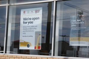 A sign in the window at a McDonald's restaurant states no dine-in seating in Oklahoma City (Sue Ogrocki/AP)