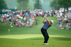 LOUISVILLE, KY - AUGUST 10:  Ernie Els of South Africa hits his second shot on the 12th hole during the final round of the 96th PGA Championship at Valhalla Golf Club on August 10, 2014 in Louisville, Kentucky.  (Photo by Andrew Redington/Getty Images)