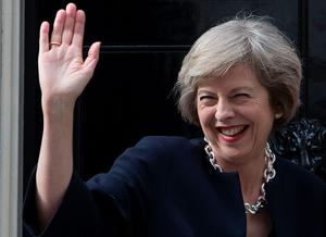 Britain's new Prime Minister Theresa May waves outside 10 Downing Street in central London on July 13, 2016 on the day she takes office following the formal resignation of David Cameron.  Theresa May took office as Britain's second female prime minister on July 13 charged with guiding the UK out of the European Union after a deeply devisive referendum campaign ended with Britain voting to leave and David Cameron resigning.   / AFP PHOTO / JUSTIN TALLISJUSTIN TALLIS/AFP/Getty Images
