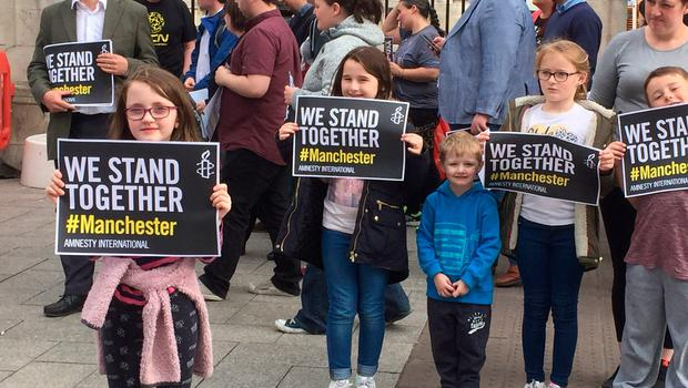 People gather for a vigil outside Belfast City Hall, after a 23-year-old man was arrested in connection with the Manchester concert bomb attack. PRESS ASSOCIATION Photo. Picture date: Tuesday May 23, 2017. The attack killed 22 people, including children, and injured dozens more in the worst terrorist incident to hit Britain since the July 7 atrocities. See PA story POLICE Explosion. Photo credit should read: Michael McHugh/PA Wire