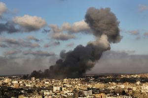 Smoke from an Israeli strike rises over Gaza City, Thursday, July 24, 2014.  (AP Photo/Adel Hana)