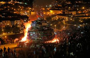 A bonfire in the bogside area of Londonderry, which is traditionally torched on August 15 to mark a Catholic feast day celebrating the assumption of the Virgin Mary into heaven, but in modern times the fire has become a source of contention and associated with anti-social behaviour. PRESS ASSOCIATION Photo. Picture date: Tuesday August 15, 2017. Disorder flared in Londonderry on Monday night as bonfire-builders attacked police and members of the public. Police said those gathered at the controversial fire site in Derry's Bogside threw rocks and stones at local people before targeting police with petrol bombs and other missiles. See PA story ULSTER Bonfire. Photo credit should read: Niall Carson/PA Wire