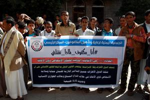 Yemeni blind men hold a banner during a demonstration gathering disabled people to protest after a center for the blind was reportedly destroyed by Saudi-led airstrikes in the capital Sanaa on January 6, 2016. Nearly 6,000 people have been killed since March, according to UN figures. At least 2,795 of them are civilians.    AFP PHOTO / MOHAMMED HUWAISMOHAMMED HUWAIS/AFP/Getty Images
