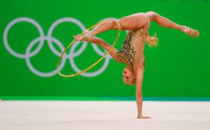 RIO DE JANEIRO, BRAZIL - AUGUST 19: Yana Kudryavtseva of Russia performs during the Rhythmic Gymnastics Individual All-Around  on August 20, 2016 at Rio Olympic Arena in Rio de Janeiro, Brazil.  (Photo by Laurence Griffiths/Getty Images) *** BESTPIX ***