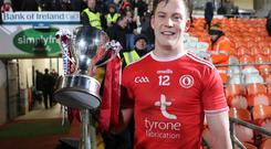 Tyrone's Kieran McGeary with the Dr McKenna Cup. Credit: INPHO/Declan Roughan