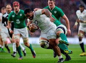 England's number 8 Billy Vunipola (C) is tackled during the Six Nations international rugby union match between England and Ireland at Twickenham in south west London on February 27, 2016.   / AFP / GLYN KIRKGLYN KIRK/AFP/Getty Images