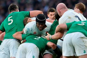 England's lock Maro Itoje (C) is sandwiched in the middle of a maul during the Six Nations international rugby union match between England and Ireland at Twickenham in south west London on February 27, 2016.   / AFP / GLYN KIRKGLYN KIRK/AFP/Getty Images