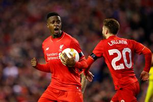 LIVERPOOL, ENGLAND - APRIL 14:  Divock Origi (L) of Liverpool celebrates scoring his team's opening goal with Adam Lallana during the UEFA Europa League quarter final, second leg match between Liverpool and Borussia Dortmund at Anfield on April 14, 2016 in Liverpool, United Kingdom.  (Photo by Clive Brunskill/Getty Images)