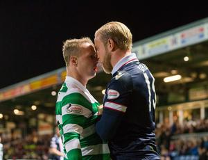 Ross County's Andrew Davies (right) and Celtic's Leigh Griffiths (left) exchange words during the Ladbrokes Scottish Premiership match at the Global Energy Stadium, Dingwall. PRESS ASSOCIATION Photo. Picture date: Wednesday October 26, 2016. See PA story SOCCER Ross County. Photo credit should read: Jeff Holmes/PA Wire. EDITORIAL USE ONLY