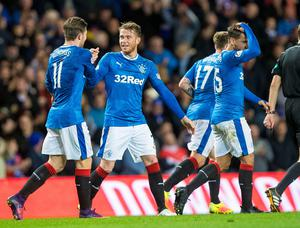 Rangers' Joe Garner (second left) celebrates scoring his side's first goal during the Ladbrokes Scottish Premiership match at the Ibrox Stadium, Glasgow. PRESS ASSOCIATION Photo. Picture date: Wednesday October 26, 2016. See PA story SOCCER Rangers. Photo credit should read: Craig Watson/PA Wire. EDITORIAL USE ONLY