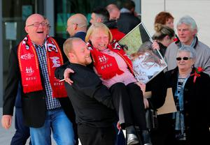 WARRINGTON, ENGLAND - APRIL 26:  Relatives of Hillsborough victims show their emotions as they depart Birchwood Park after hearing the conclusions of the Hillsborough inquest on April 26, 2016 in Warrington, England. The fresh inquests into the 1989 Hillsborough disaster, in which 96 football supporters were crushed to death, concluded on April 26, 2016 with a verdict of unlawful killing, after the initial verdicts were quashed. Relatives of Liverpool supporters who died in Britain's worst sporting disaster gathered in the purpose-built court to hear the jury's verdict in Warrington after a 25 year fight to overturn the accidental death verdicts handed down at the initial 1991 inquiry.  (Photo by Dave Thompson/Getty Images)