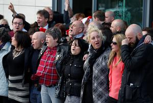 Relatives of those who died in the Hillsborough disaster sing You'll Never Walk Alone outside the Hillsborough inquests in Warrington, where the inquest jury concluded that the 96 Liverpool fans who died were unlawfully killed. PRESS ASSOCIATION Photo. Picture date: Tuesday April 26, 2016. See PA story INQUEST Hillsborough. Photo credit should read: Joe Giddens/PA Wire
