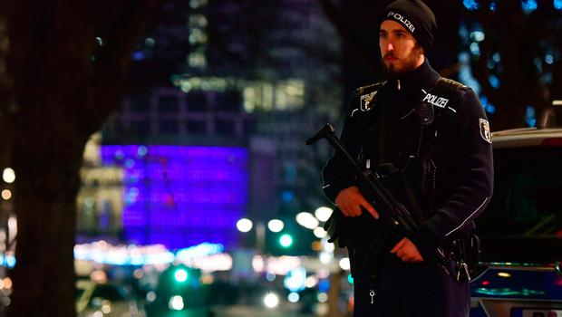 A policeman stands near the site where a truck speeded into a christmas market in Berlin, on December 19, 2016 killing nine persons and injuring at least 50 people. / AFP PHOTO / John MACDOUGALLJOHN MACDOUGALL/AFP/Getty Images