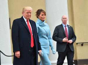 US President-elect and his wife Melania leave St. John's Episcopal Church on January 20, 2017, before Trump's inauguration. / AFP PHOTO / Nicholas KammNICHOLAS KAMM/AFP/Getty Images