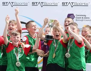 Winning feeling: Glentoran captain Lucas Miskimmin lifts the trophy after his side defeated Dungannon United Youth in the 2019 Minor final