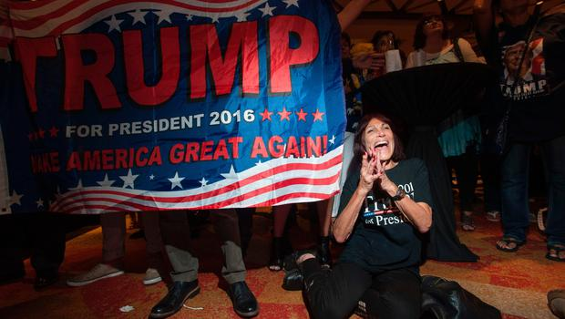 Supporter of Republican candidate Donald Trump, Robin Labani, 50, of Gilbert, Arizona cheers as election results come in during a viewing party at a hotel in downtown Phoenix, Arizona on November 8, 2016. Millions of Americans voted November 8th for their new leader in a historic election that will either elevate Democrat Hillary Clinton as their first woman president or hand power to maverick populist Donald Trump. / AFP PHOTO / Laura SegallLAURA SEGALL/AFP/Getty Images