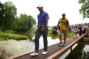 LOUISVILLE, KY - AUGUST 07:  Tiger Woods of the United States cross the bridge to the second tee during the first round of the 96th PGA Championship at Valhalla Golf Club on August 7, 2014 in Louisville, Kentucky.  (Photo by Warren Little/Getty Images)