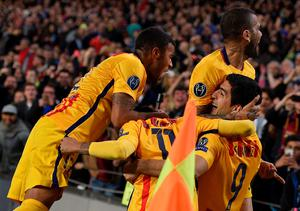 Barcelona's Uruguayan forward Luis Suarez (R) celebrates with teammates after scoring a goal during the UEFA Champions League quarter finals first leg football match FC Barcelona vs Atletico de Madrid at the Camp Nou stadium in Barcelona on April 5, 2016. / AFP PHOTO / LLUIS GENELLUIS GENE/AFP/Getty Images